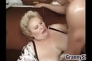 Fat together with breasty granny enjoying a ding-dong