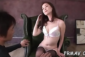 Japanese darling amazes 2 cocks concerning randy oral