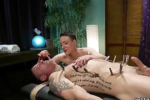 Masseuse sucks dick to tied up slave