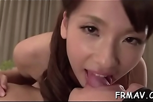 Glamorous asian uses her face hole to tame a taxing pecker