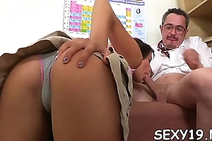 Sweet darling is delighting age-old teacher concerning blowjob engulfing